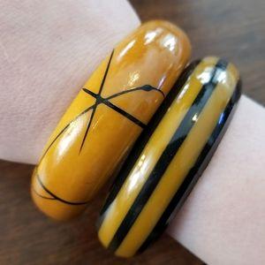 Two vintage plastic bangle bracelets bakelite?